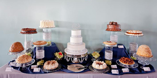 Blue Owl Wedding Dessert Buffet with white wedding cake pies